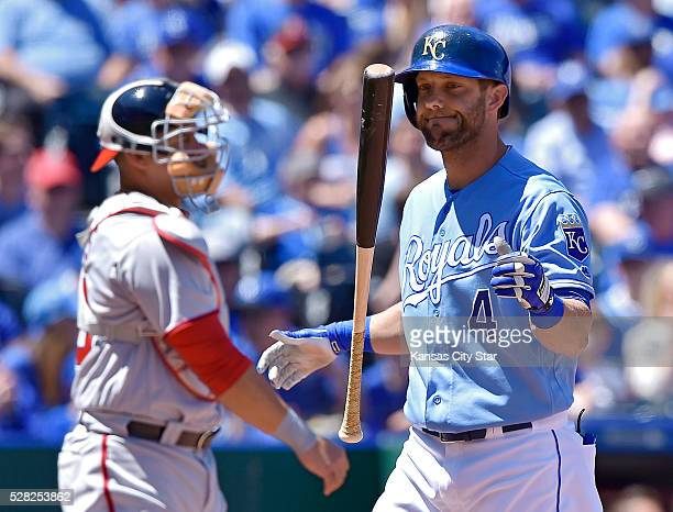 Kansas City Royals' Alex Gordon strikes out in the second inning as Washington Nationals catcher Wilson Ramos tosses the ball back to the mound...