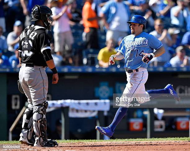 Kansas City Royals' Billy Burns scores in front of Chicago White Sox catcher Omar Narvaez on a double by Whit Merrifield in the sixth inning during...
