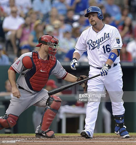 Kansas City Royals' Billy Butler is tagged out by Los Angeles Angels catcher Chris Iannetta on a dropped third strike to end the first inning at...