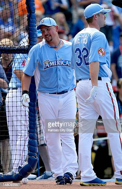 Kansas City Royals' Billy Butler walked past Baltimore Orioles' Matt Wieters as they rotated in and out of the batting cage during Monday's batting...