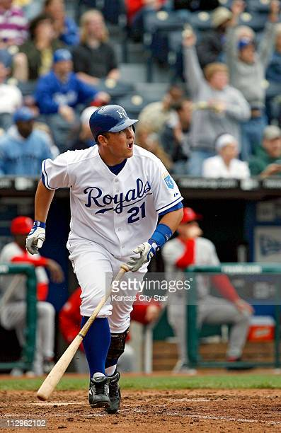 Kansas City Royals' Billy Butler watches his sacrifice fly head to right field in the sixth inning at Kauffman Stadium in Kansas City Missouri...