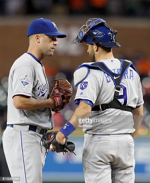 Kansas City Royals catcher Drew Butera talks to starting pitcher Danny Duffy during the second inning of a baseball game against the Detroit Tigers...