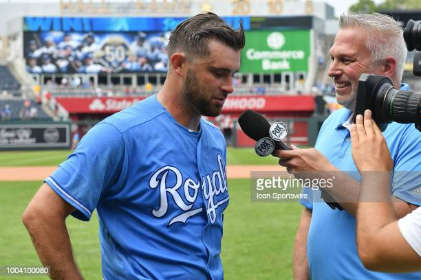 Kansas City Royals catcher Drew Butura talks with local Fox Sports reporter Joel Goldberg after a MLB game between the Minnesota Twins and the Kansas...
