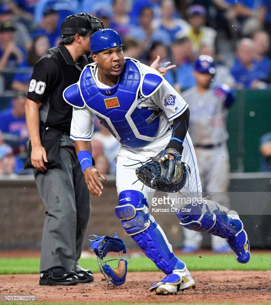 Kansas City Royals catcher Salvador Perez chases after a wild pitch from starting pitcher Jakob Junis that allowed Chicago Cubs' Ben Zobrist to score...