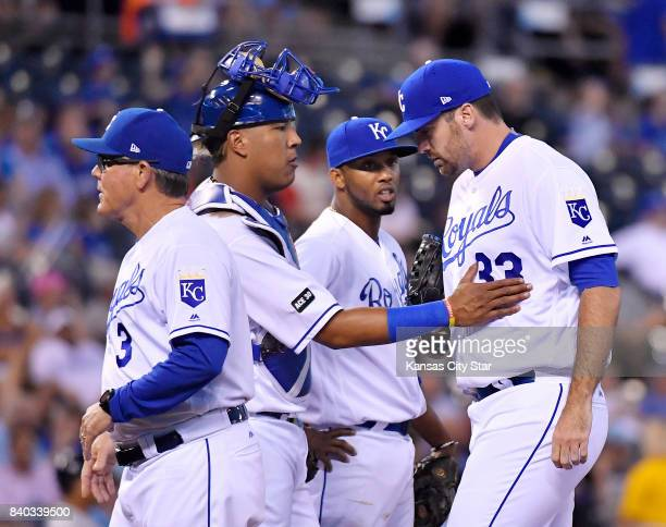 Kansas City Royals catcher Salvador Perez gives relief pitcher Brian Flynn a pat on the chest after manager Ned Yost relieved starting pitcher Ian...