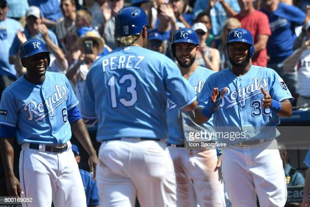 Kansas City Royals catcher Salvador Perez is greeted at home plate after hitting a gamewinning home run in the eighth inning during a MLB game...