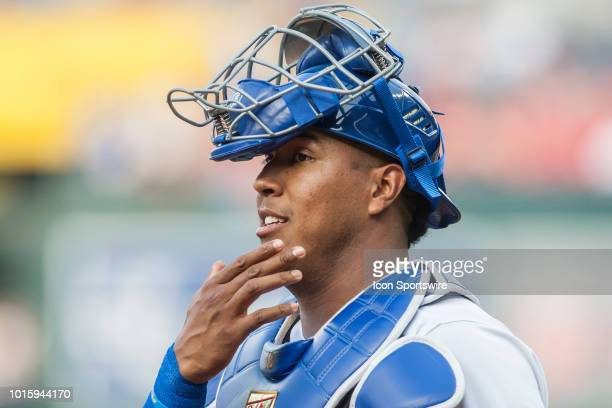 Kansas City Royals catcher Salvador Perez jokes with members of the opposing teams bench during the MLB regular season game between the St Louis...