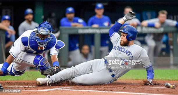 Kansas City Royals catcher Salvador Perez left tags out the Toronto Blue Jays' Russell Martin at home trying to score on a ground ball on August 13...