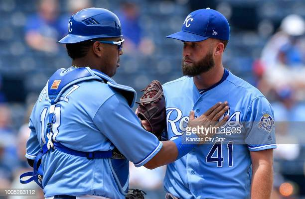 Kansas City Royals catcher Salvador Perez makes a visit to the mound to visit with starting pitcher Danny Duffy in the fourrun fourth inning against...