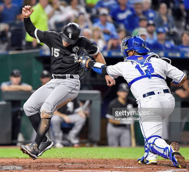 Kansas City Royals catcher Salvador Perez tags out the Chicago White Sox's Adam Engel at the plate trying to score on a fielder's choice hit into by...