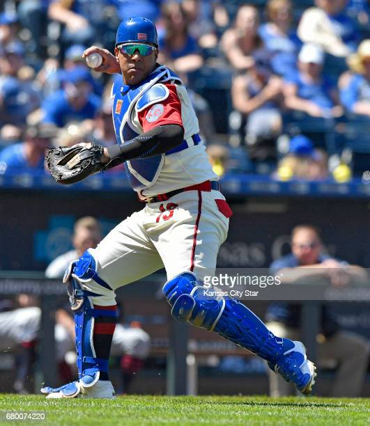 Kansas City Royals catcher Salvador Perez throws out Cleveland Indians' Abraham Almonte on a bunt in the fifth inning on Sunday May 7 2017 at...