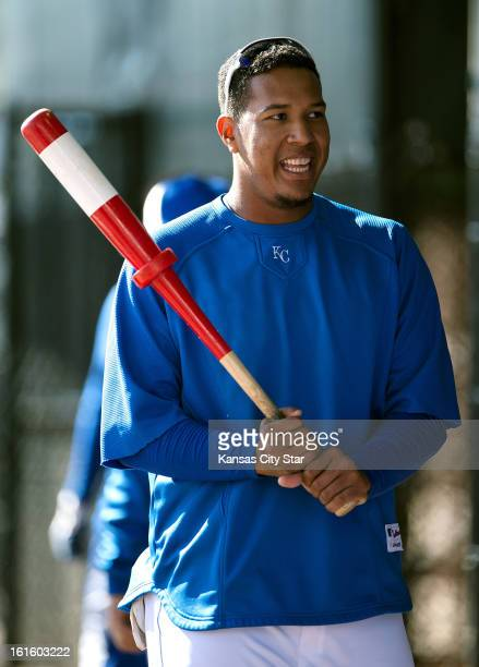 Kansas City Royals catcher Salvador Perez waits to take his turn in the batting cage during an informal spring training workout for position players...