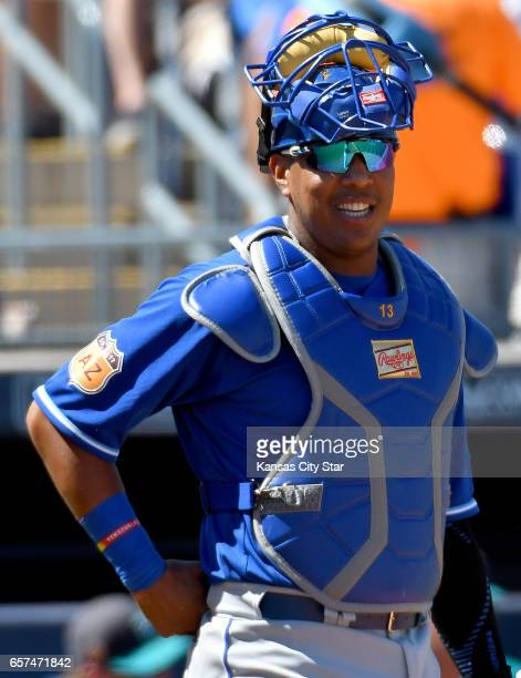 Kansas City Royals catcher Salvador Perez works behind the plate against the Seattle Mariners during spring training in Peoria Ariz on Friday March...