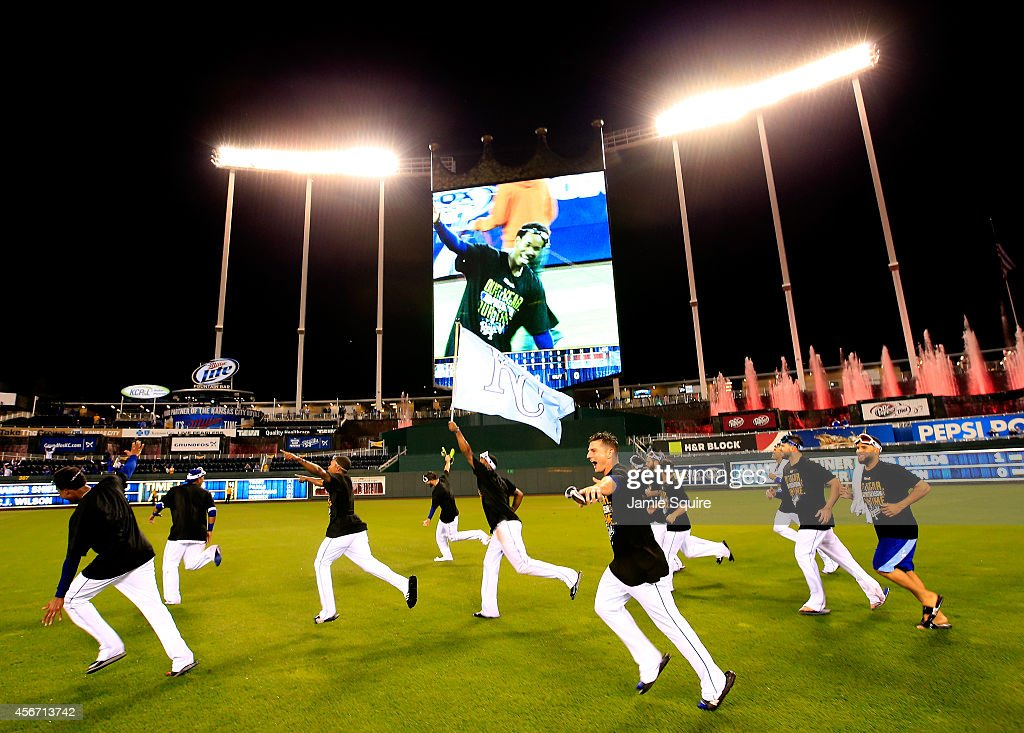 Kansas City Royals celebrate by running through the outfield after the Royals defeated the Los Angeles Angels 9-3 to win game 3 of the American League Division Series at Kauffman Stadium on October 5, 2014 in Kansas City, Missouri.
