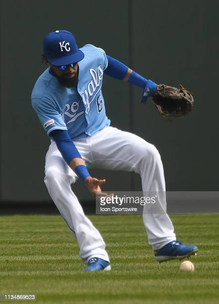 Kansas City Royals center fielder Billy Hamilton fields a ball hit by Minnesota Twins left fielder Eddie Rosario for a double in the second inning...