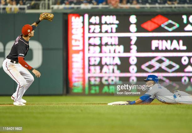 Kansas City Royals center fielder Billy Hamilton hits a double in the tenth inning as Washington Nationals shortstop Trea Turner takes the late throw...