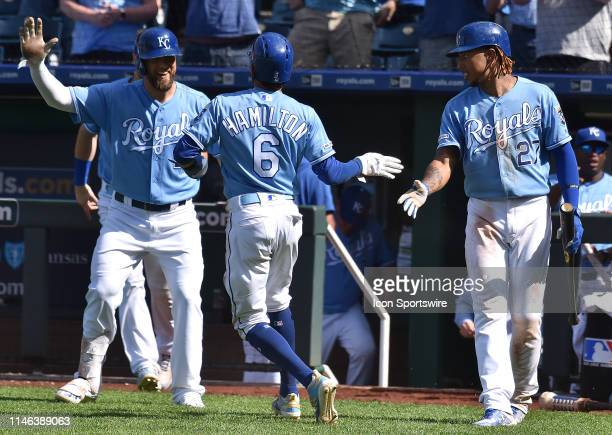 Kansas City Royals center fielder Billy Hamilton is congratulate at home plate after scoring the gamewinning run during a MLB game between the New...