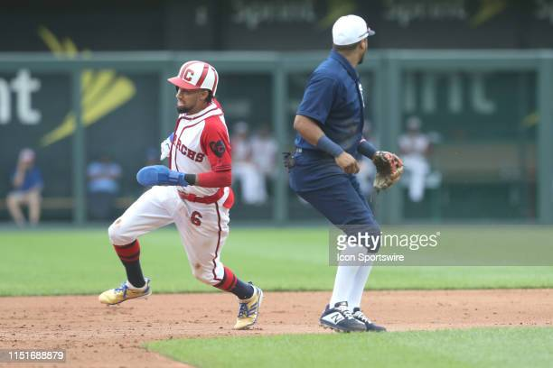 Kansas City Royals center fielder Billy Hamilton rounds second base after teammate Alex Gordon hit a standup double during the third inning of a game...