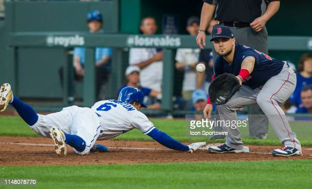 Kansas City Royals center fielder Billy Hamilton slides back to first base to avoid the out by Boston Red Sox third baseman Michael Chavis during the...