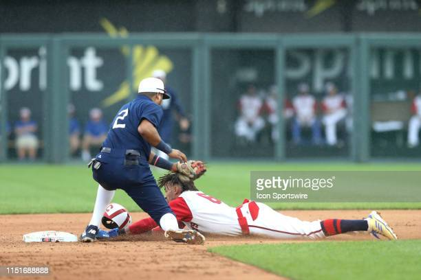 Kansas City Royals center fielder Billy Hamilton slides safely into second base as Minnesota Twins second baseman Luis Arraez tries to make the tag...