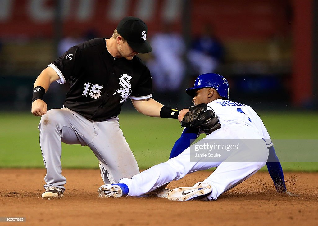 Kansas City Royals center fielder Jarrod Dyson #1 steals second as Chicago White Sox second baseman Gordon Beckham #15 applies the tag too late during the 9th inning of the game at Kauffman Stadium on May 20, 2014 in Kansas City, Missouri.