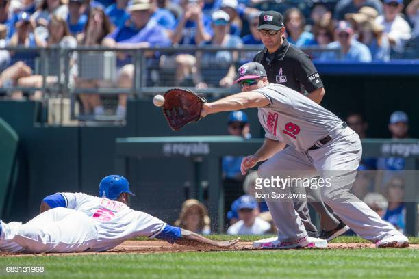 Kansas City Royals center fielder Lorenzo Cain dives back to first base as Baltimore Orioles first baseman Chris Davis reaches for the ball during...