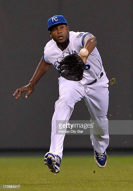Kansas City Royals center fielder Lorenzo Cain runs down a fly ball for an out on the Cleveland Indians' Asdrubal Cabrera in the first inning on...