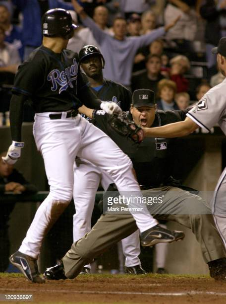 Kansas City Royals Centerfielder Carlos Beltran is signaled safe after sliding into home by the home plate umpire in the third inning of a game...