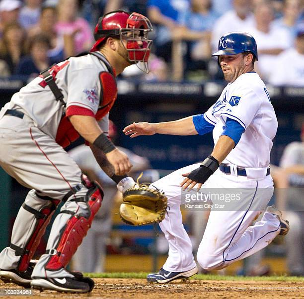 Kansas City Royals' David DeJesus right scores before the throw to Los Angeles Angels catcher Mike Napoli in the fifth inning at Kauffman Stadium in...