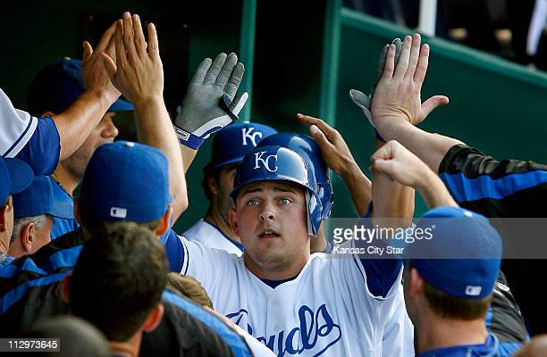 Kansas City Royals designated hitter Billy Butler is congratulated after he crushed a first inning three-run home run against the Seattle Mariners on...