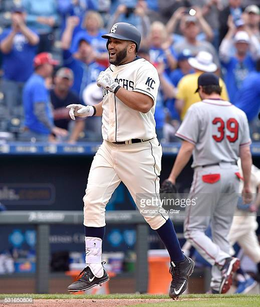 Kansas City Royals designated hitter Kendrys Morales celebrates his game winning two run home in the 13th inning as he rounds the bases past Atlanta...