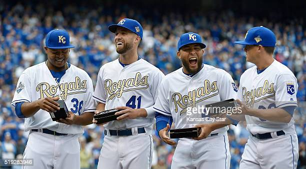 Kansas City Royals' Edinson Volquez Danny Duffy Kelvin Herrera and Kris Medlen look over their 2015 World Series rings during the ceremony on Tuesday...