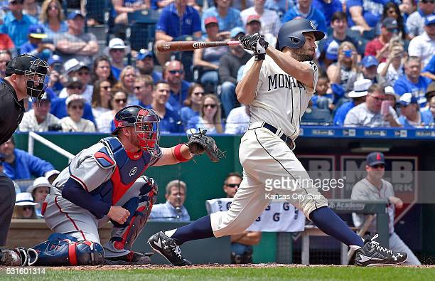 Kansas City Royals' Eric Hosmer follows through on an RBI single to score Alcides Escobar in the first inning in front of Atlanta Braves catcher...