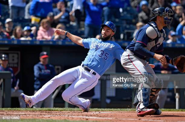 Kansas City Royals' Eric Hosmer scores behind Minnesota Twins catcher Jason Castro on a double by Salvador Perez in the second inning on Sunday April...