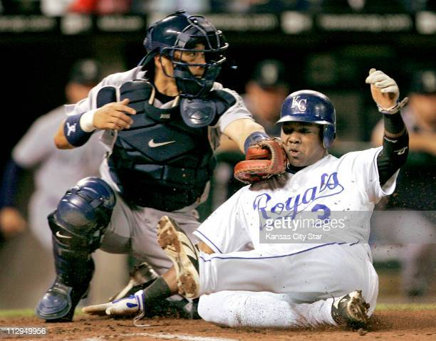 Kansas City Royals' Esteban German is tagged out at the plate by Seattle Mariners catcher Kenji Johjima on a double by Kansas City Royals' Mark...