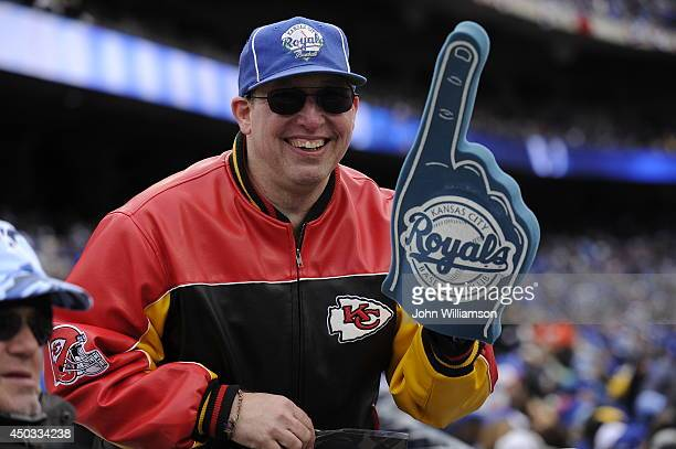 Kansas City Royals fan is seen with a foam finger during the home opener against the Chicago White Sox on Friday April 4 2014 at Kauffman Stadium in...
