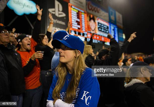 A Kansas City Royals fan turns her back to the field when the San Francisco Giants' Joe Panik doubles in two runs during the bottom of the seventh...