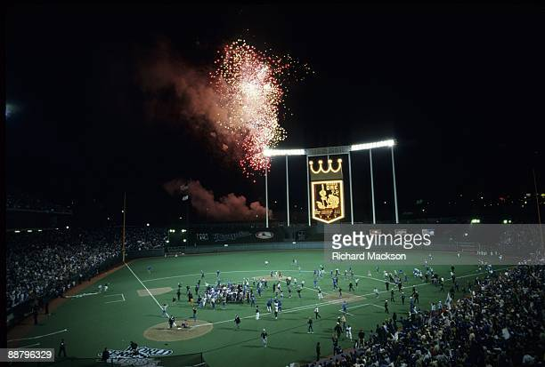 Kansas City Royals' fans run on the field iafter the Royals defeated the St Louis Cardinals in game seven of the World Series October 27 1985 at...