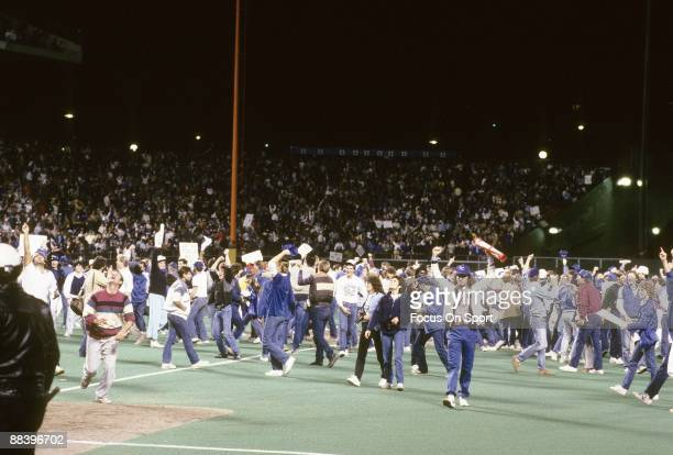 Kansas City Royals' fans run on to the field in jubilation after the Royals defeated the St Louis Cardinals in game seven of the World Series October...