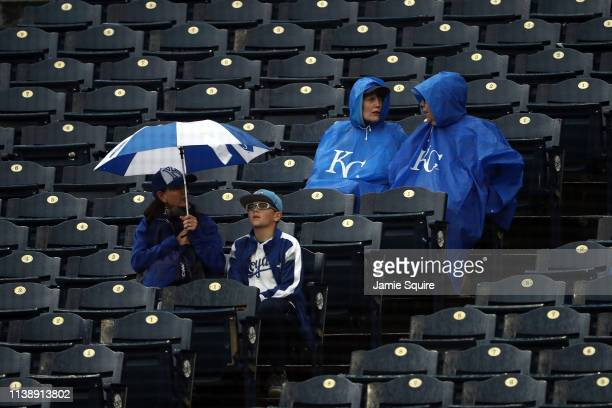 Kansas City Royals fans wait during a rain delay prior to the opening day game between the Chicago White Sox and the Kansas City Royals at Kauffman...