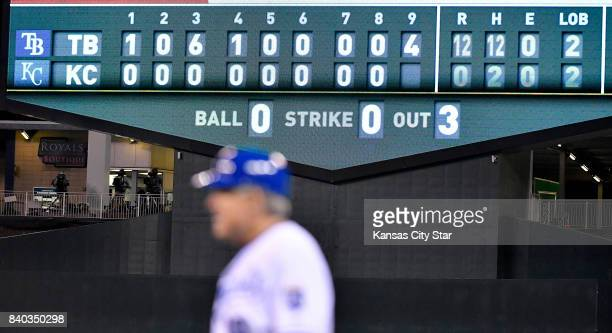 Kansas City Royals first base coach Rusty Kuntz heads to the dugout after Melky Cabrera ground out to end the game with a 120 shutout by the Tampa...