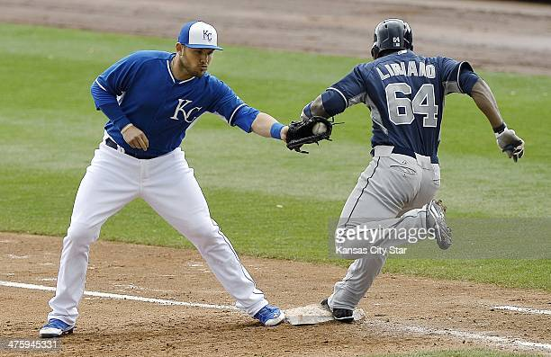 Kansas City Royals first baseman Brandon Laird left tags out the San Diego Padres' Rymer Liriano at first in the sixth inning in spring training on...