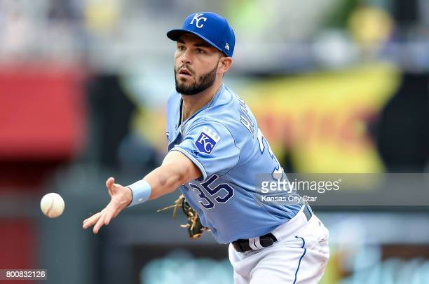 Kansas City Royals first baseman Eric Hosmer flips the ball to Kansas City Royals relief pitcher Neftali Feliz for a ground out in the seventh inning...