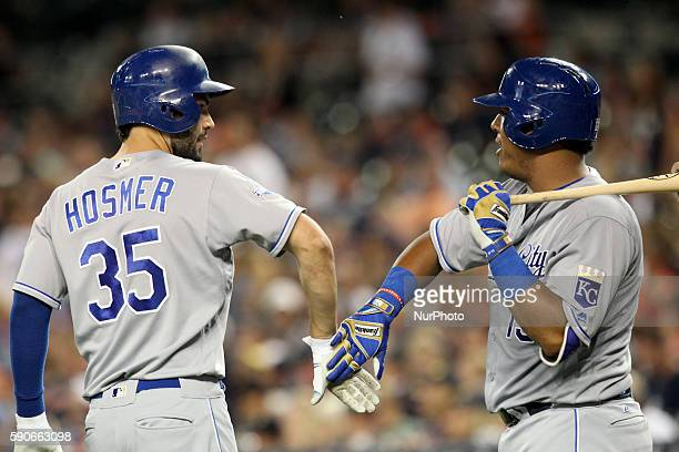 Kansas City Royals first baseman Eric Hosmer is congratulated by catcher Salvador Perez after his solo homerun in the seventh inning of a baseball...