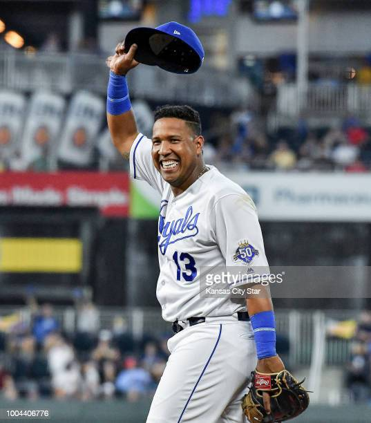 Kansas City Royals first baseman Salvador Perez acknowledges the cheers from teammates and fans after flipping the ball behind his back to relief...