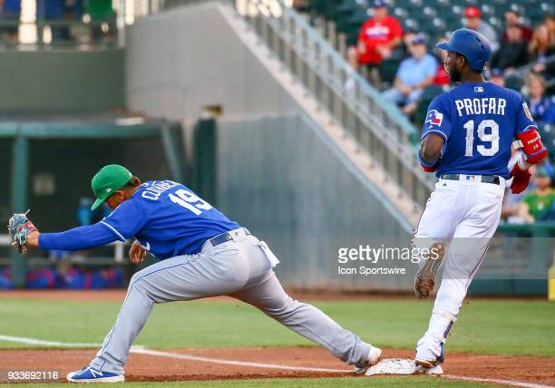Kansas City Royals infielder Cheslor Cuthbert gets the out at first baseduring the MLB Spring Training baseball game between the Kansas City Royals...