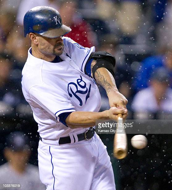 Kansas City Royals' Jason Kendall connects on a sacrifice fly in the second inning against the New York Yankees at Kauffman Stadium in Kansas City,...