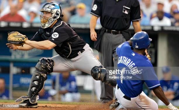Kansas City Royals' Joey Gathright slides ahead of the throw to Toronto Blue Jays' catcher Gregg Zaun on a sacrafice fly by the Royals' Mark...