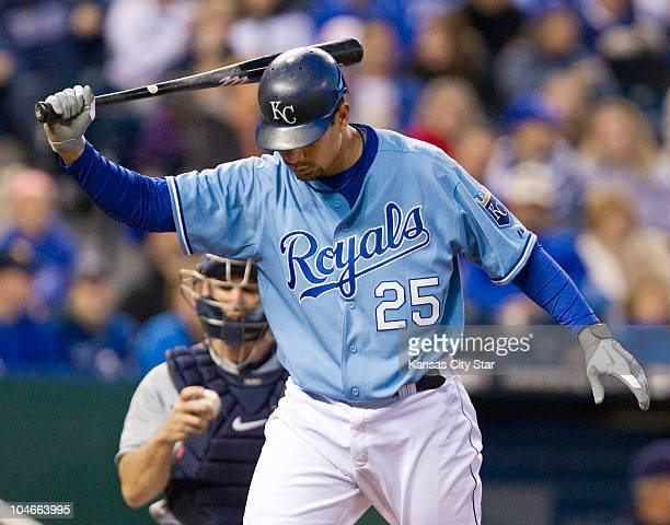 Kansas City Royals' Kila Ka'aihue swings his bat in frustration after striking out in the third inning against the Tampa Bay Rays at Kauffman Stadium...