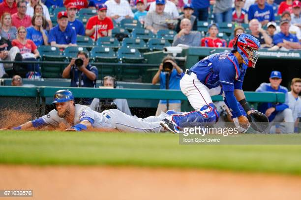 Kansas City Royals Left field Alex Gordon slides past Texas Rangers Catcher Robinson Chirinos to score a run during the first inning of the MLB game...